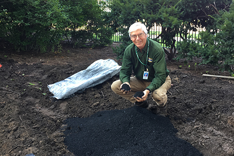 Gary Gilmore with biochar at the Governor's Residence raingarden