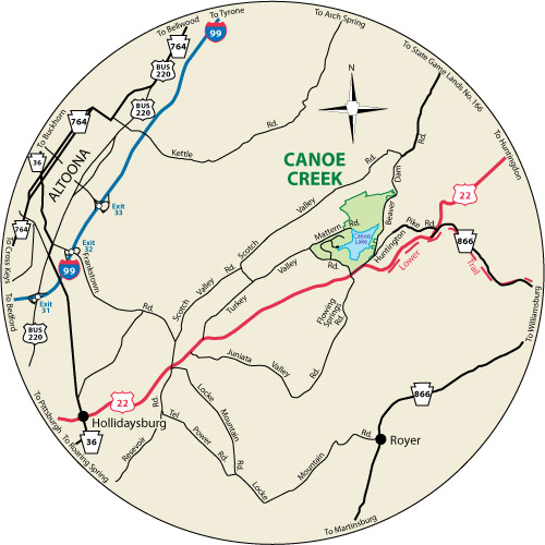 A circular map that shows the roads near Canoe Creek State Park