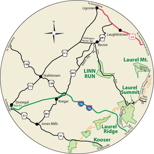 A circular map that shows the roads surrounding Linn Run State Park