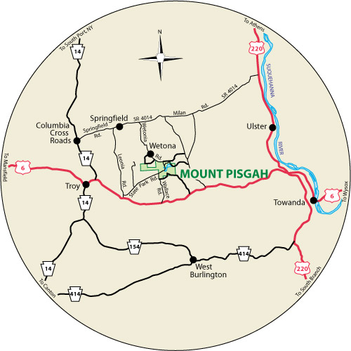A circular map that shows the roads surrounding Mount Pisgah State Park