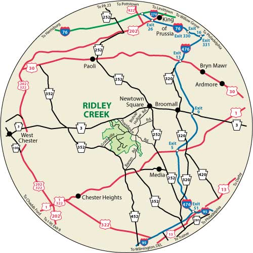 A circular map that shows the roads surrounding Ridley Creek State Park