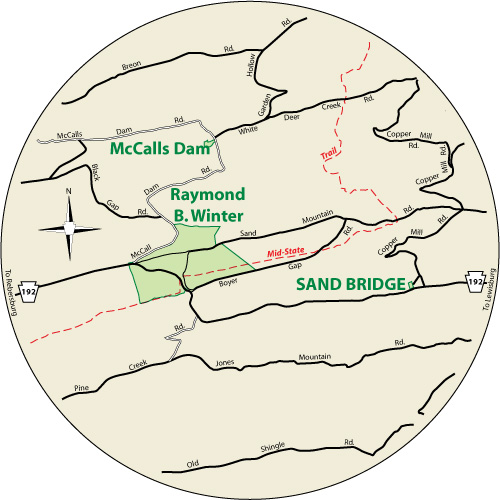 A circular map that shows the roads surrounding Sand Bridge State Park