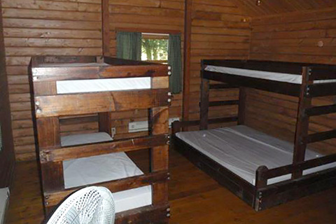 Bunkbeds are in a cozy wooden cottage at Chapman State Park.