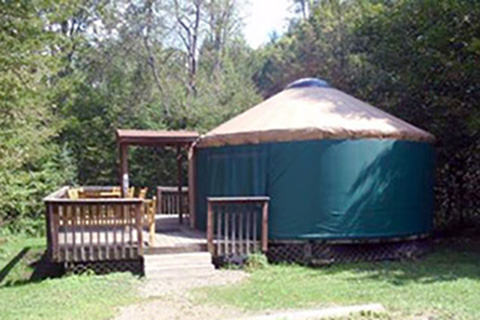 A round tent has a porch at Chapman State Park.