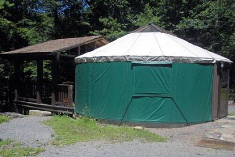 A round tent has a covered porch at Clear Creek State Park.