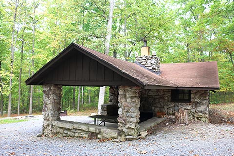 A stone cabin is in the forest at Cowans Gap State Park.