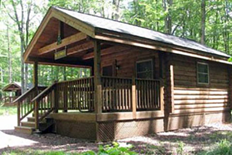 A modern log cabin is near trees at Hickory Run State Park.
