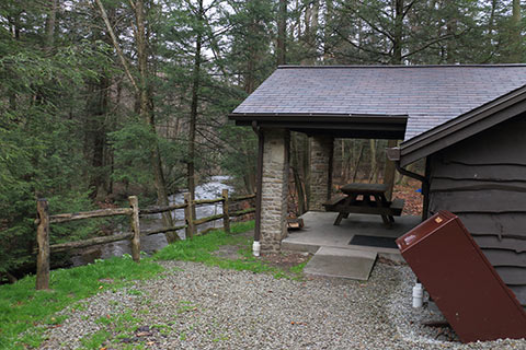 A rustic cabin overlooks a creek at Kooser State Park.