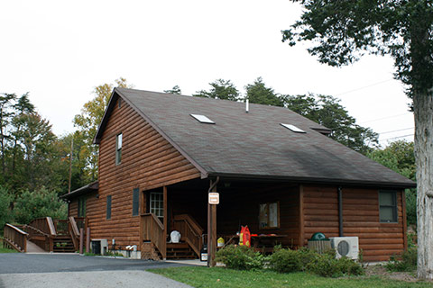 The modern log cabin has skylights and air conditioning at Little Buffalo State Park.