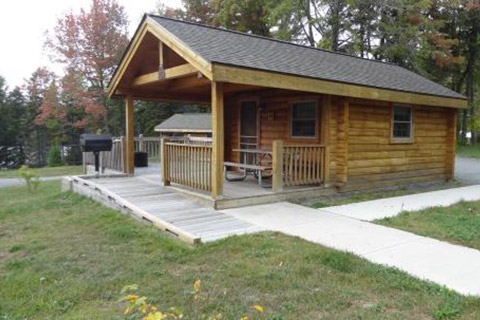 A cozy modern cabin has cement sidewalks at Promised Land State Park.