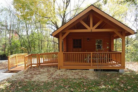 A log cabin has a porch and ramp at Ryerson Station State Park.