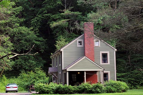 A green house is near a forest at Sinnemahoning State Park.