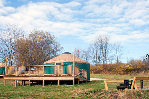 A round tent, a yurt, is on a platform with a nice wooden deck at Yellow Creek State Park.