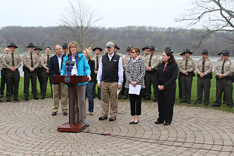 DCNR Secretary Dunn speaks next to Governor Wolf, other officals, and state park and forest managers about life-saving naloxone.